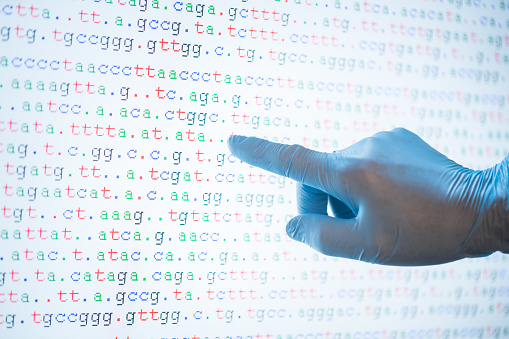 istock DNA code on screen with one hand touch the screen 821359362