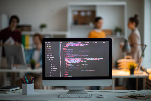 Coded stuff on screen Workplace of it-developer or programmer with computer screen with coded data on background of office workers web designer stock pictures, royalty-free photos & images