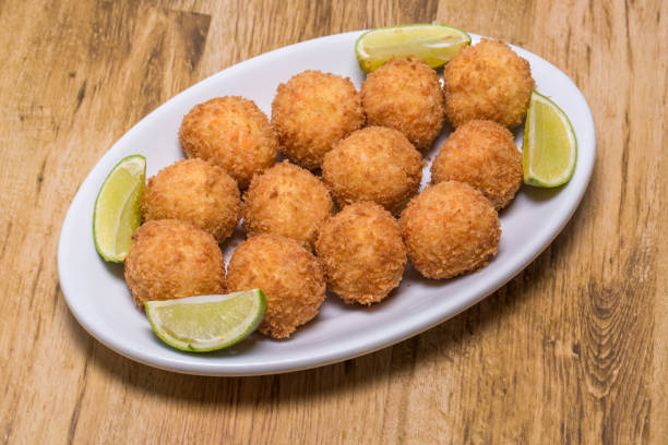 codfish balls, in portuguese it is called bolinho de bacalhau. codfish balls, in portuguese it is called bolinho de bacalhau. estudio stock pictures, royalty-free photos & images