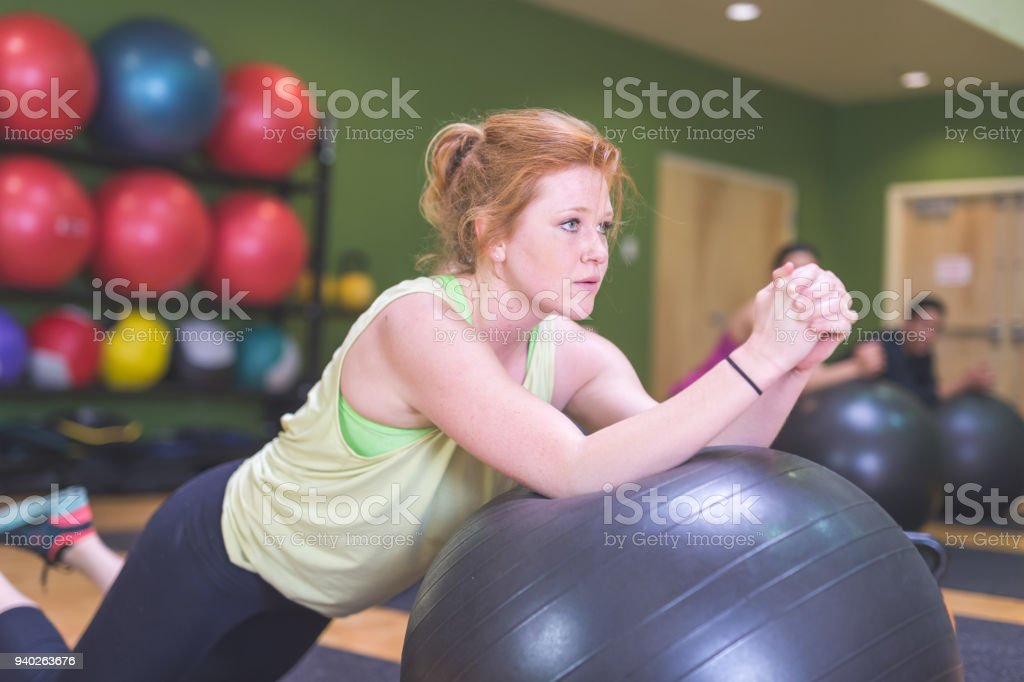 Co-ed Group Exercising Together at Fitness Facility stock photo