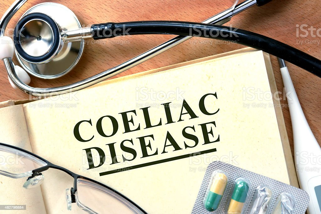 Coeliac disease concept. Book with stethoscope and pills. stock photo