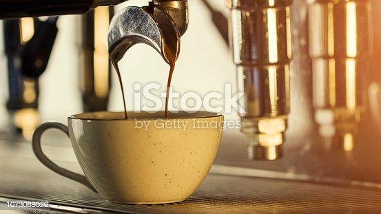 Cofee machine is making a cofee, close up, soft light