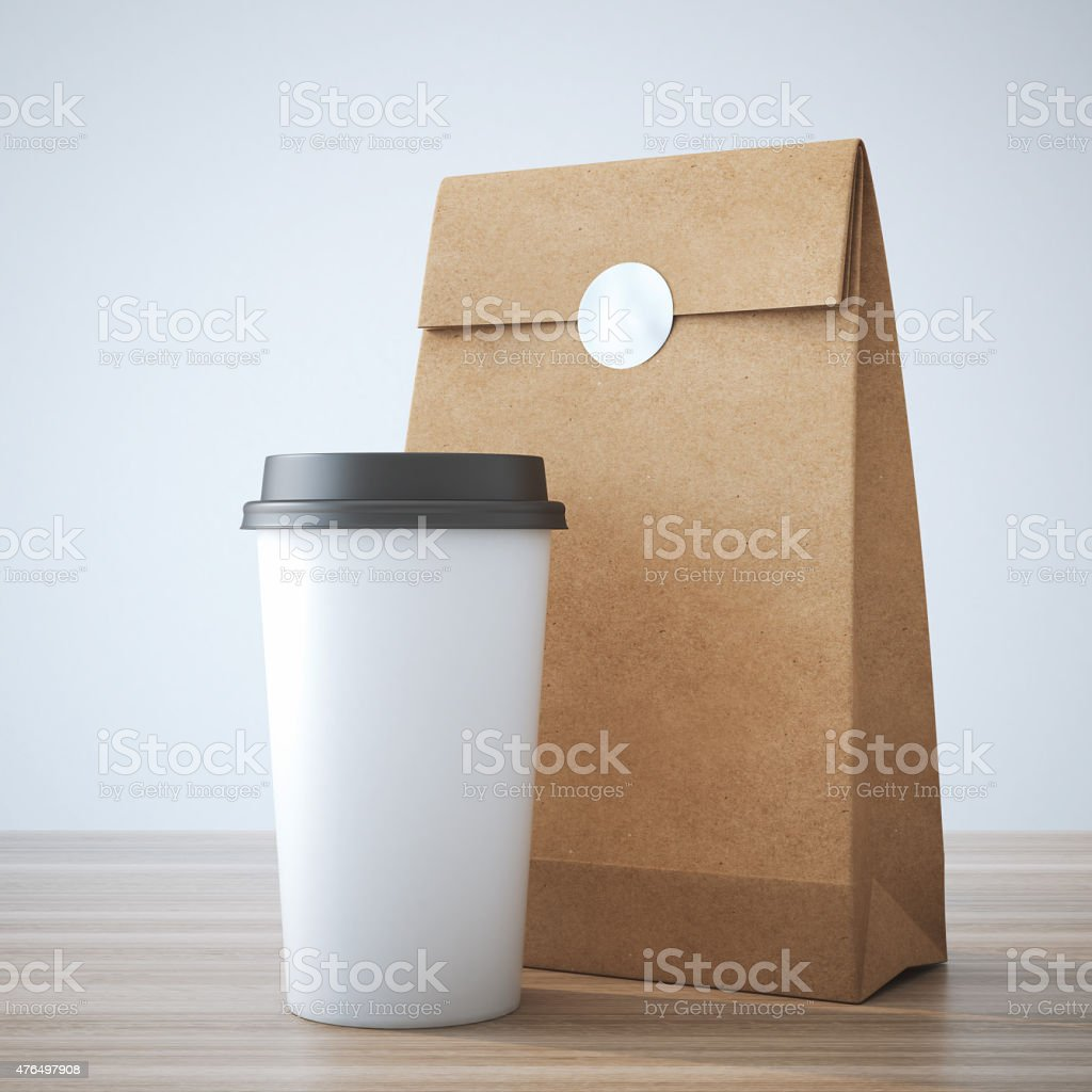 Coffe cup and paper bag stock photo