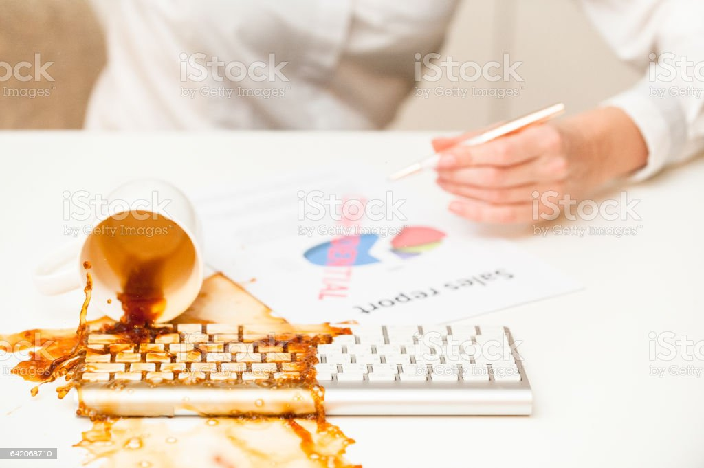 Coffe spilled on modern keyboard stock photo