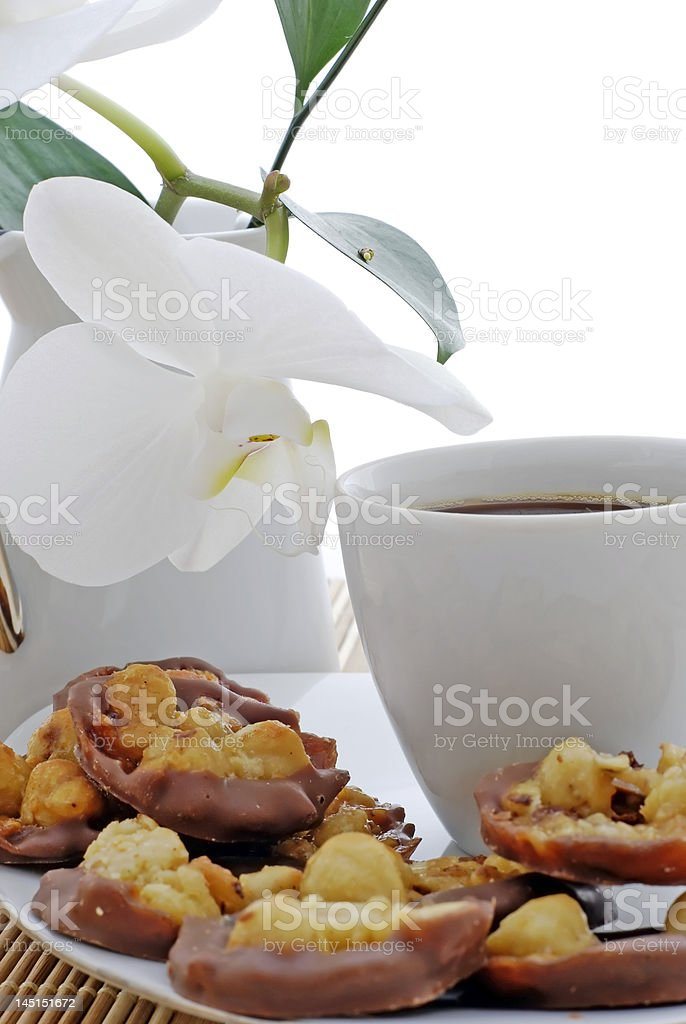 coffe with cakes and orchid flower royalty-free stock photo
