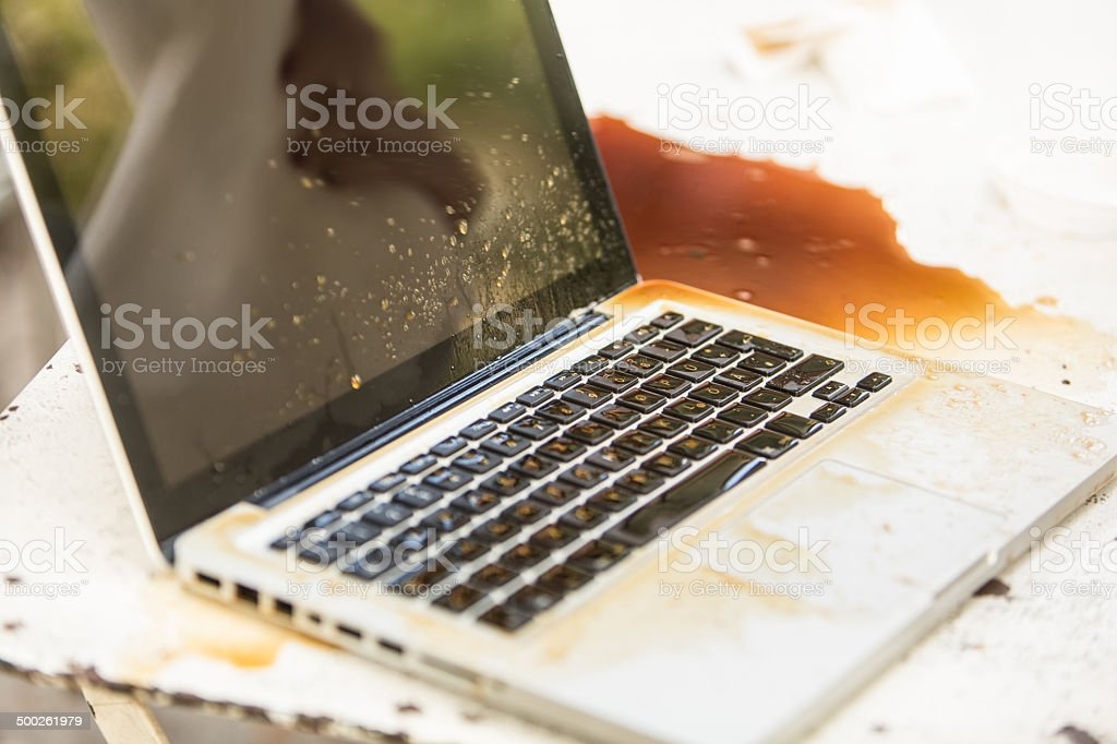 Coffee accident on computer stock photo