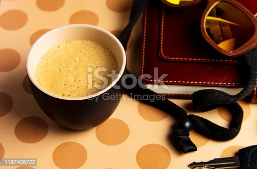 istock Coffee and accessories on a table top view 1137425722