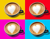 Coffee mugs with heart shaped foam on tiled color background. New froth trends with pop art.