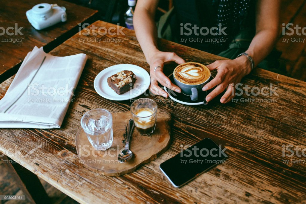 Coffee and cake on the table in a cafe in London downtown stock photo