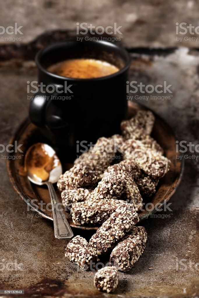 Coffee and chocolate candy on a vintage metal plate stock photo