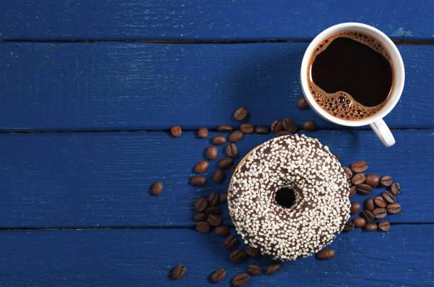 Coffee and chocolate donut stock photo