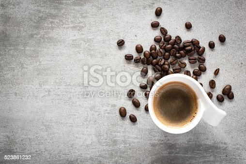 istock Coffee and coffee beans on a concrete table 523861232
