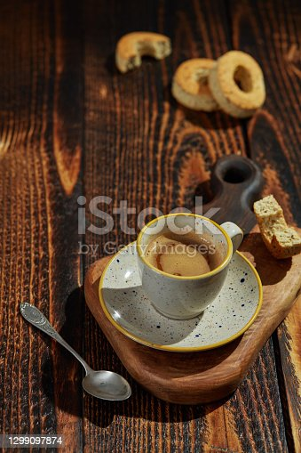 Coffee and cookies on rustic background