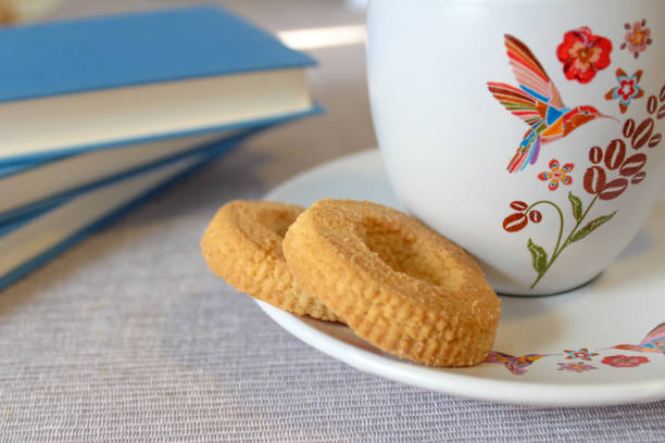 Coffee and cookies with a book stock photo