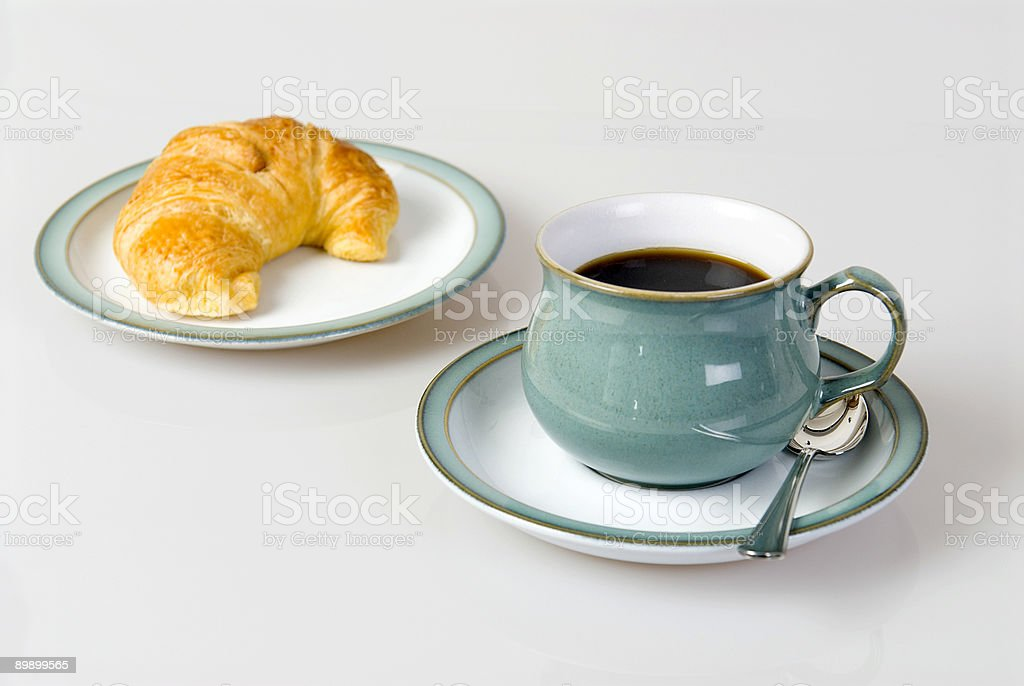 Coffee and croissant for breakfast royalty-free stock photo