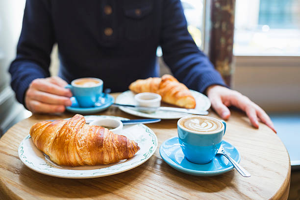 Coffee and croissant. French breakfast for two (Paris, France) Coffee and croissant. French breakfast for two (Paris, France) croissant stock pictures, royalty-free photos & images