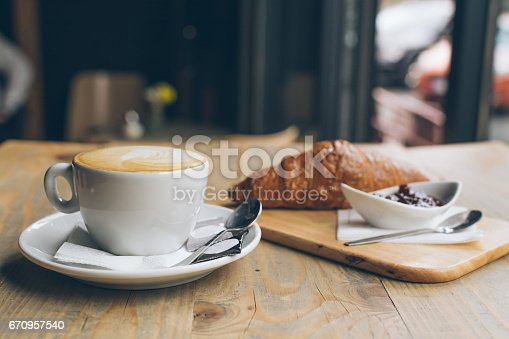 istock Coffee and croissant 670957540