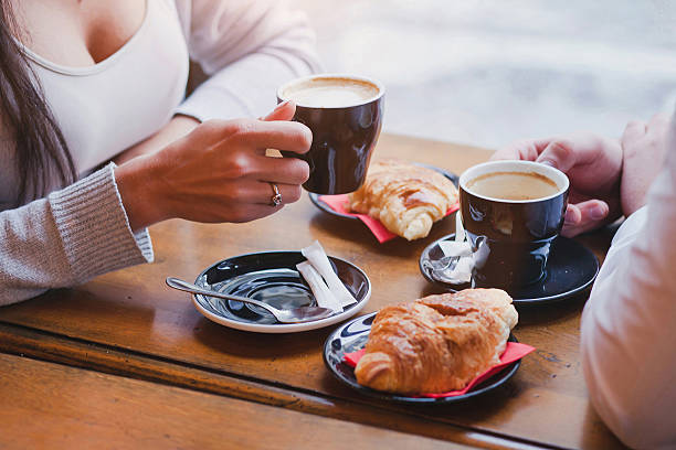 coffee and croissants in cafe, couple having breakfast - foto stock