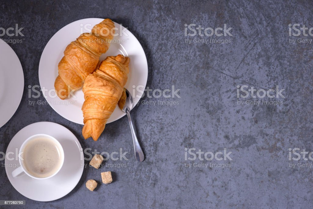 Coffee and croissants with copy space stock photo
