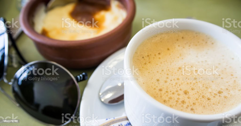 coffee and dessert call creme brulee before travelling and sunglasses - Royalty-free Creme Brulee Stock Photo