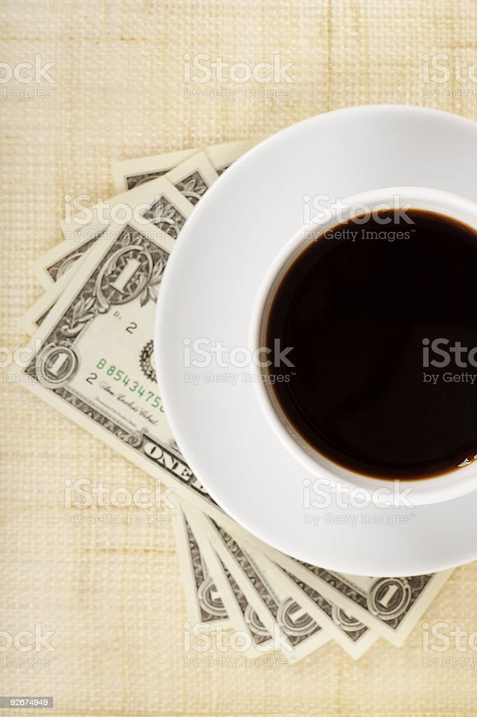 Coffee and dollars royalty-free stock photo