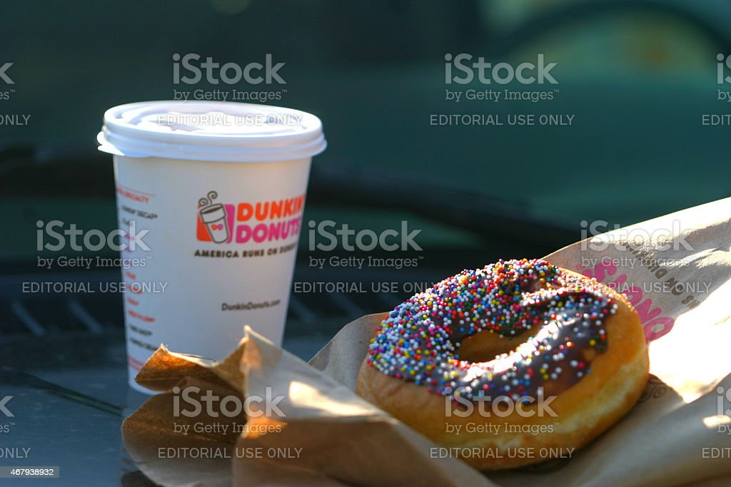 Coffee and Donut Brooklyn, New York, USA - April 12, 2014: A Dunkin Donuts coffee and doughnut.  2015 Stock Photo