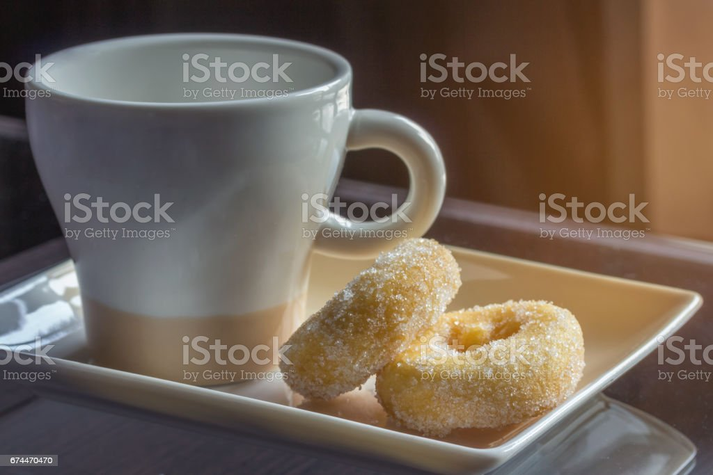 Coffee and donuts at breakfast stock photo