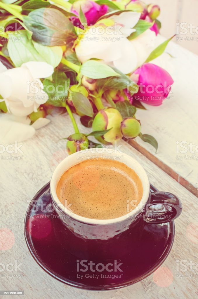 Coffee and flowers peony. A cup of coffee and Peonies on a white...