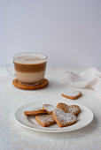 Cup of coffee with heart shaped homemade cookies