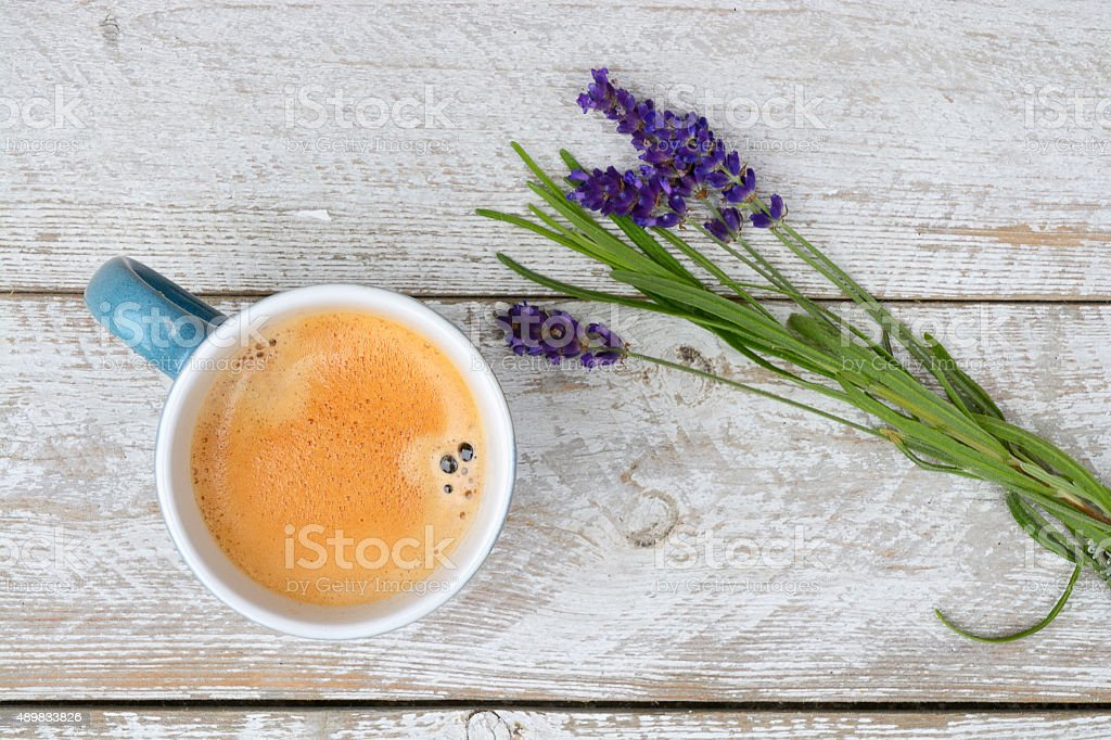 Coffee and lavender on white wooden background with copy space stock photo