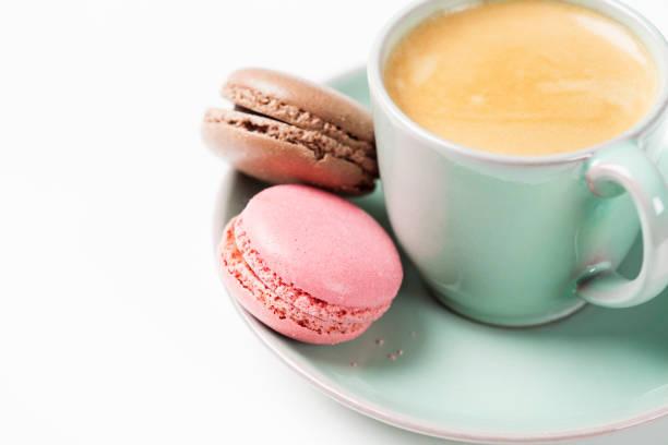 Coffee and macarons stock photo