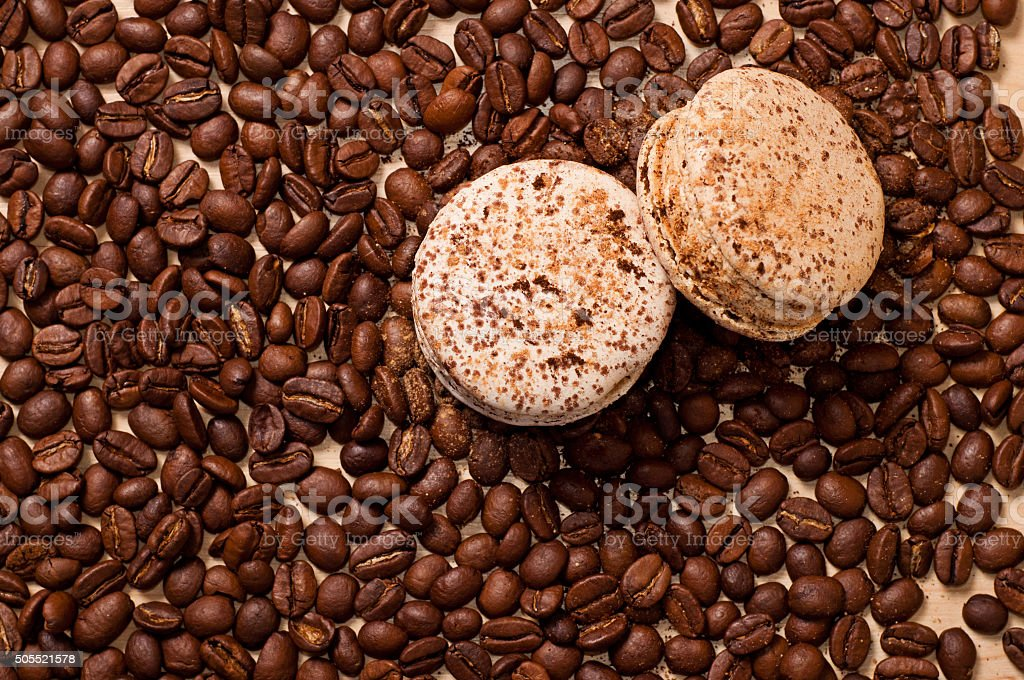 coffee and macaroons the coffee beans and two macaroons Baked Stock Photo