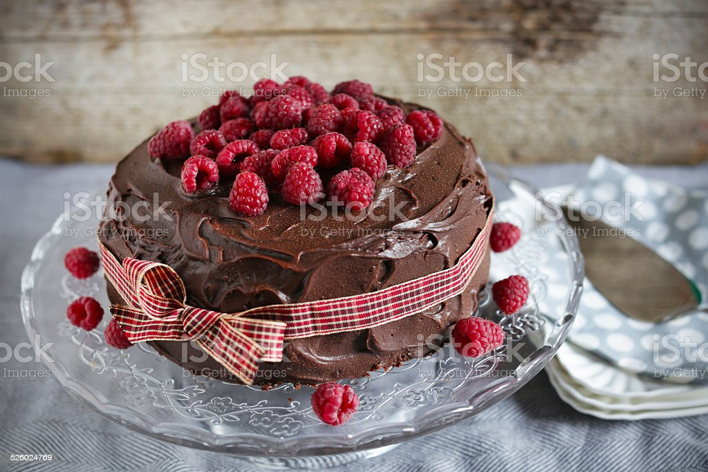 Coffee and milk chocolate ganache cake with raspberry jam stock photo