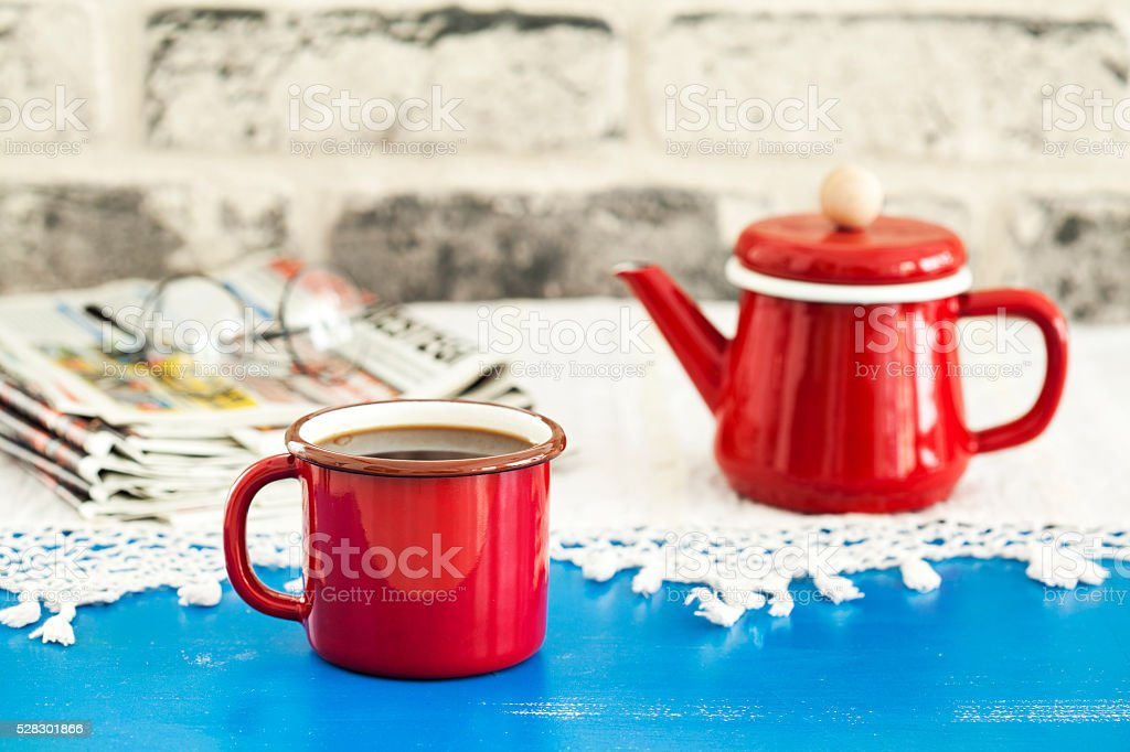 Coffee and newspaper on wooden table stock photo