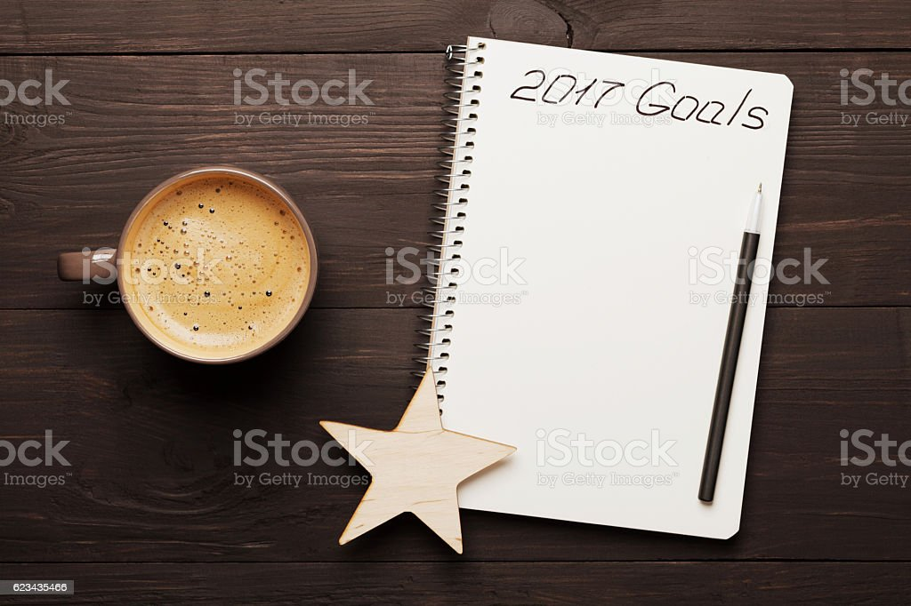 Coffee and notebook with goals for 2017. Planning and motivation. stock photo