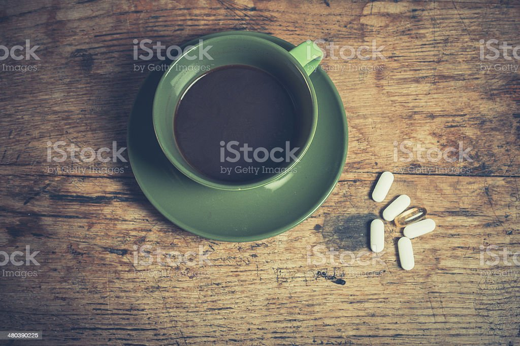Coffee and pills stock photo