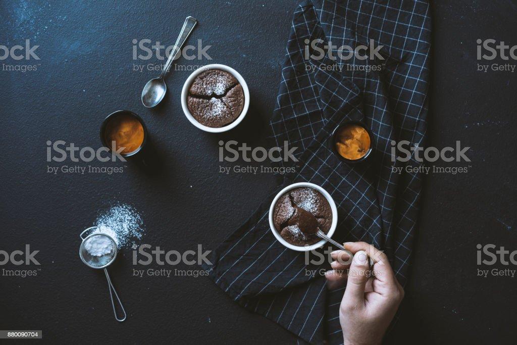 Coffee and souffle on blackboard table top stock photo