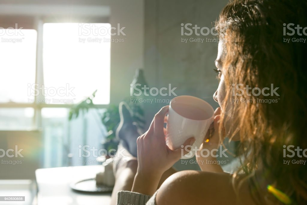 Coffee and sun's rays stock photo