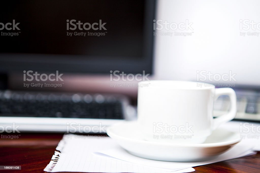 Coffee and the calculator on monitor royalty-free stock photo