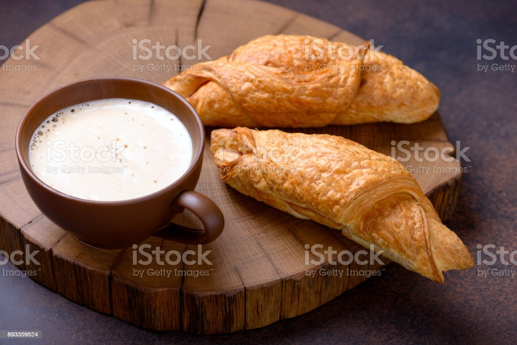 Coffee and two fresh croissants stock photo