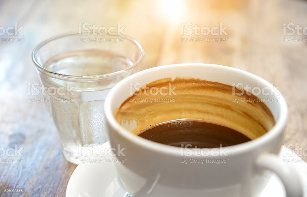 Coffee and water glass on wooden table. royalty-free stock photo
