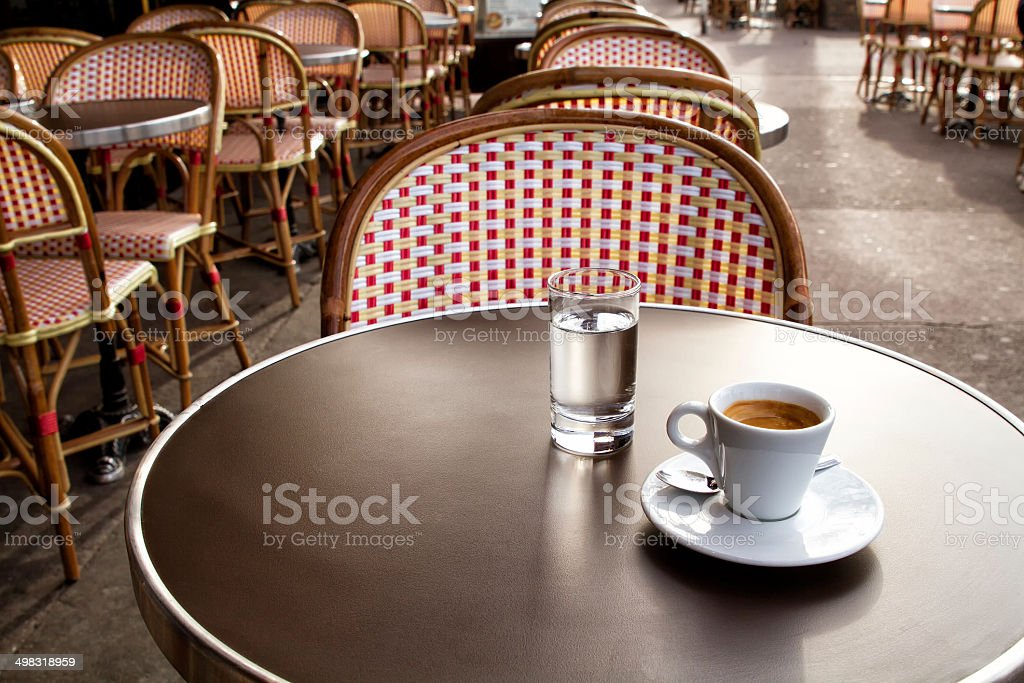 Coffee and water on a table of parisian's bar - Royalty-free Absence Stock Photo