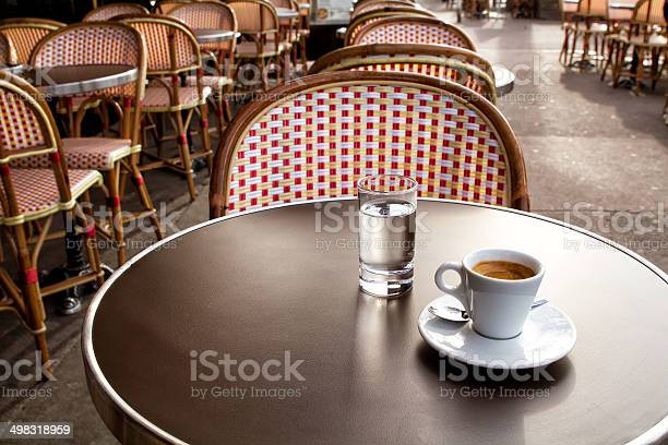 Coffee And Water On A Table Of Parisians Bar Stock Photo - Download Image Now