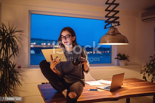 Beautiful woman drinking coffee and relaxing at home.