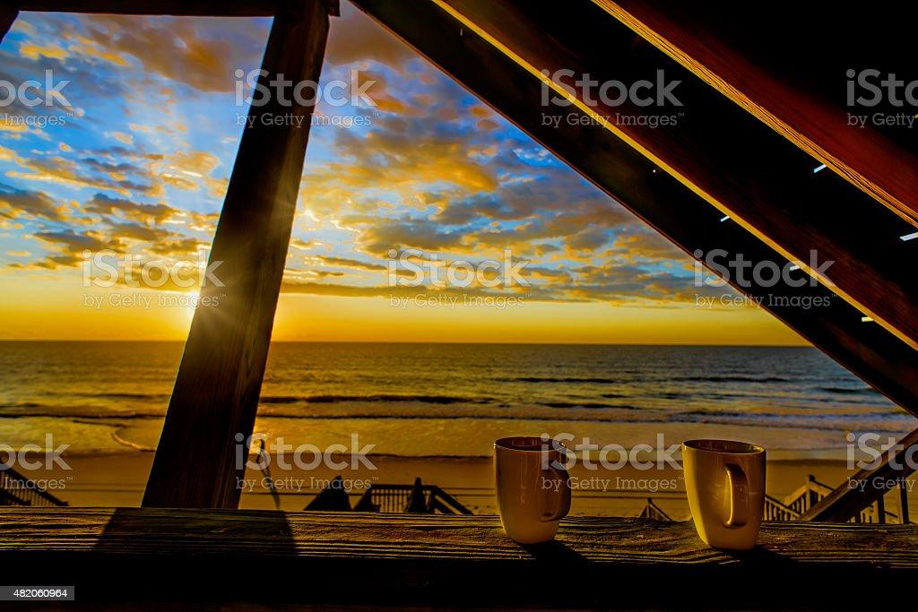 Coffee at Sunrise on the Beach stock photo