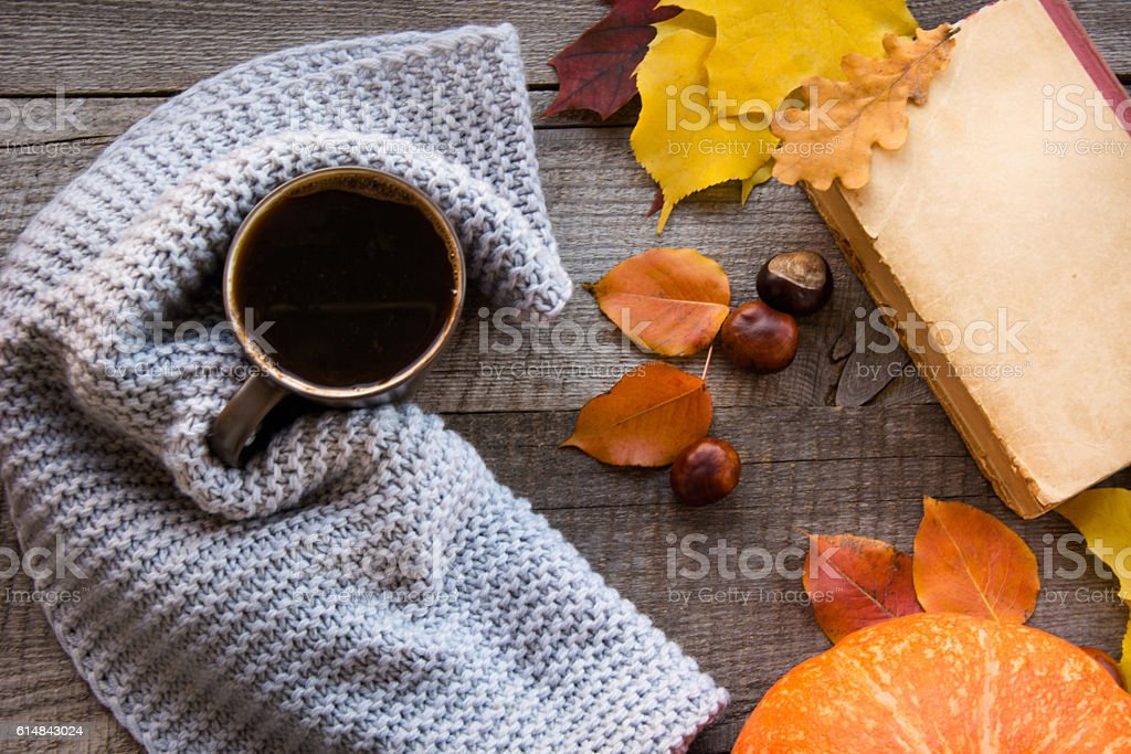 Coffee, autumn leaves and pumpkin on board. Flat lay. stock photo