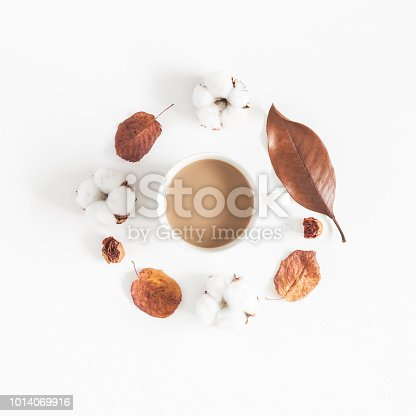 istock Coffee, autumn leaves, cotton flowers. Flat lay, top view 1014069916