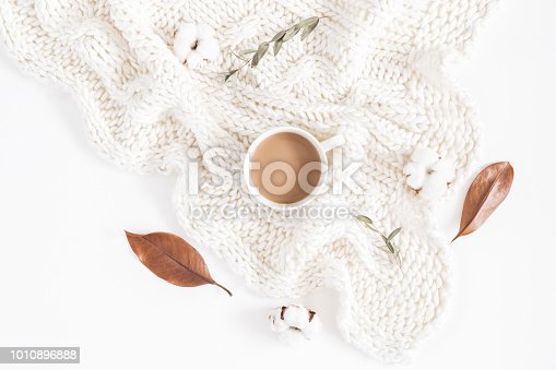 istock Coffee, autumn leaves, knitted blanket. Flat lay, top view 1010896888