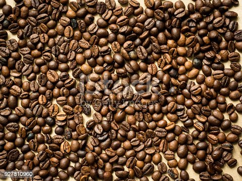 Coffee background of coffee beans and anise stars, copy space, top view