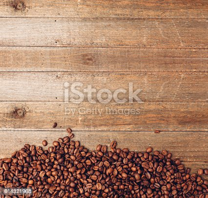 Coffee bean background on a wooden table.